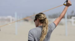 A women beach volleyball player stretching and warming up. Stock Footage