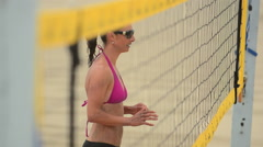 Extreme close-up selective-focus of women beach volleyball players at the net. Stock Footage