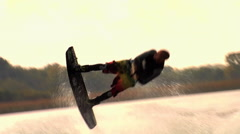 A man doing a flip while wakeboarding on a lake. Stock Footage