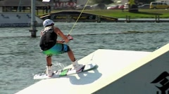 A man cable winch wakeboarding on a lake. Stock Footage