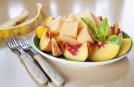 Sliced fruits peach melon Stock Photos