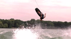 A wakeboarder crashes in the water while trying to do a risky trick. Stock Footage
