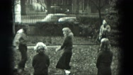 1951: five young people play keep away with ball in the front yard GERMANY Stock Footage