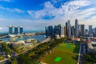 SINGAPORE - APRIL 15: Singapore city skyline and Marina Bay on April 15, 2016 Stock Photos