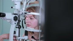 Ophthalmologist checks woman's eyes Stock Footage