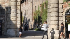 Tilt up of entrance arch of Olimpico theatre in Vicenza with tourists Stock Footage