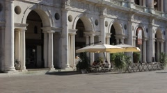 People walking in Lords Square close to Basilica Palladiana in historical center Stock Footage