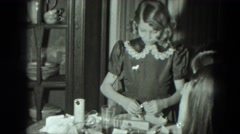 1951: young girl opens present shiny bracelet and seems to like it AUSTRIA Stock Footage