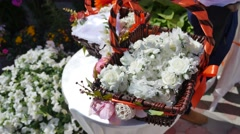 Beautiful white wedding decorations flowers in basket Stock Footage