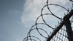 Closeup dolly shot of a barbed wire fence - Brooklyn, NYC Stock Footage