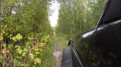 The car rides in the woods on the road slippery clay. Stock Footage
