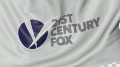Close up of waving flag with 21st Century Fox logo, seamless loop, blue Arkistovideo