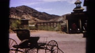 1966: horse drawn carriage set against western mountain town CALIFORNIA Stock Footage