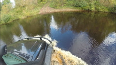 The car crossing the river in a deep place on the road. Stock Footage