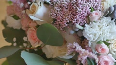 Wedding bouquet of bride - colorful flowers pink, white roses and yellow freesia Stock Footage