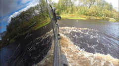 Car bravely overcomes the river on the road. Stock Footage