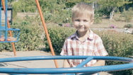 Boy playing outdoor at playground Stock Footage