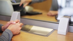 Clerk counting money and customer at bank office Stock Footage