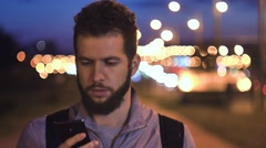 Casual young business talking on smart phone at night on La Rambla in Barcelona Stock Footage