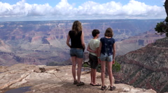Family looking over Grand Canyon Stock Footage