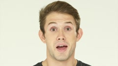 Closeup portrait of young handsome man face expressing astonishment and Stock Footage