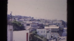1966: city is seen with tall buildings along coastal area CALIFORNIA Stock Footage