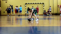 Children practice basketball Stock Footage