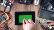 4k Technology Composition from Above of Hand Maximising Green Screen on iPad Stock Footage
