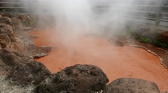 Japanese hot springs Bloody Hell Pond in Beppu Stock Footage
