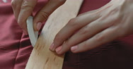 A close-up of girl's hand designer line charting on the fabric using patterns Stock Footage