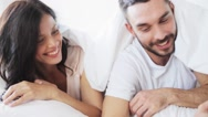 Happy couple lying in bed at home Stock Footage