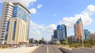 City traffic. Clouds over the city. Kunaev Avenue, Astana, Kazakhstan. Time Stock Footage