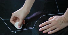 Female designer draws a dotted line on the leatherette Stock Footage