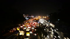 Car traffic in Delhi, India at night. Time-lapse Stock Footage
