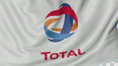 Close up of waving flag with Total S.A. logo, seamless loop, blue background Stock Footage