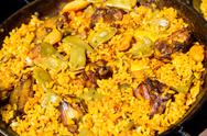 Traditional Valencian Paella With Rice And Chicken Stock Photos