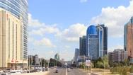 City traffic. Clouds over the city. Zoom. Kunaev Avenue, Astana, Kazakhstan. Stock Footage