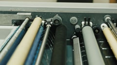 Industrial printing of posters - print production, equipment wear - the gear Stock Footage