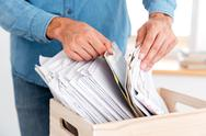 Man hands looking for documents in stack of folders Stock Photos