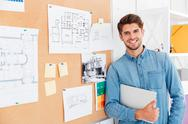 Portrait of a smiling man standing at the task board Stock Photos