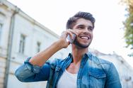 Man talking on mobile phone in the city Stock Photos