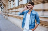 Man talking on mobile phone at the street Stock Photos