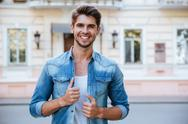 Happy attractive young man in the city Stock Photos