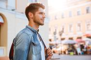 Smiling attractive young man in the city Stock Photos