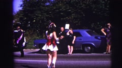 1973: dancer twirling baton in parade while being watched by onlookers LYNBROOK, Stock Footage