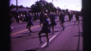 1973: girls twirling batons while marching in parade LYNBROOK, NEW YORK Stock Footage