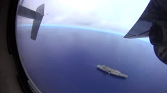 Aircraft carrier fly over in a C-2a Greyhound cargo aircraft. Stock Footage