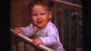 1973: cute redhead baby boy in crib reaching around grabbing at things. Stock Footage