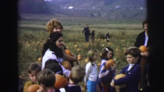1974: large group of people at pumpkin patch getting pumpkins. LYNBROOK Stock Footage