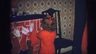 1974: girl puts her christmas sock above the fireplace LYNBROOK, NEW YORK Stock Footage